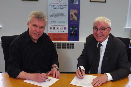 Scott Walter and Sandy Crawley signing agreement